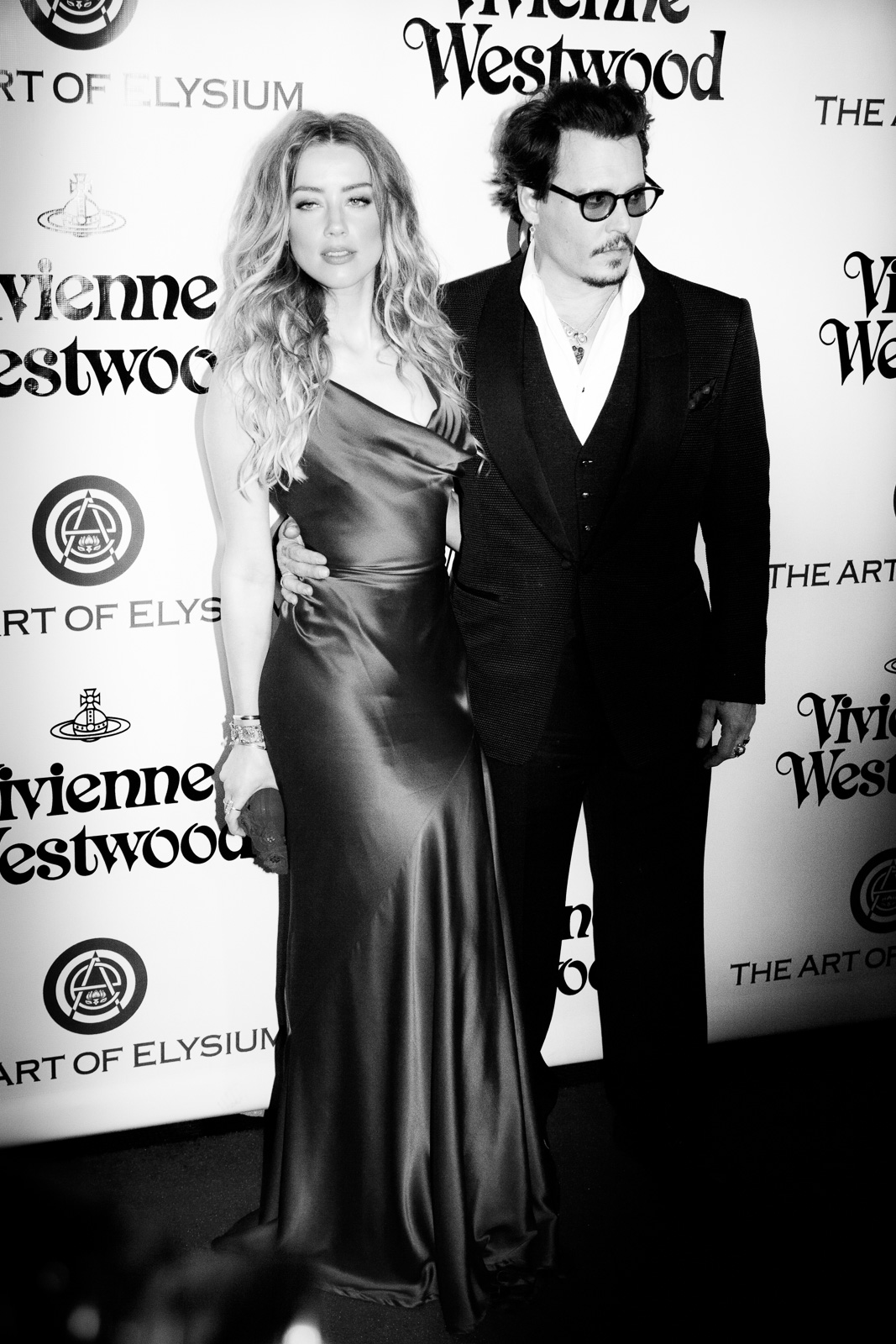Actress Amber Heard and actor Johnny Depp attend The Art of Elysium 2016 HEAVEN Gala presented by Vivienne Westwood & Andreas Kronthaler at 3LABS on January 9, 2016 in Culver City, California.