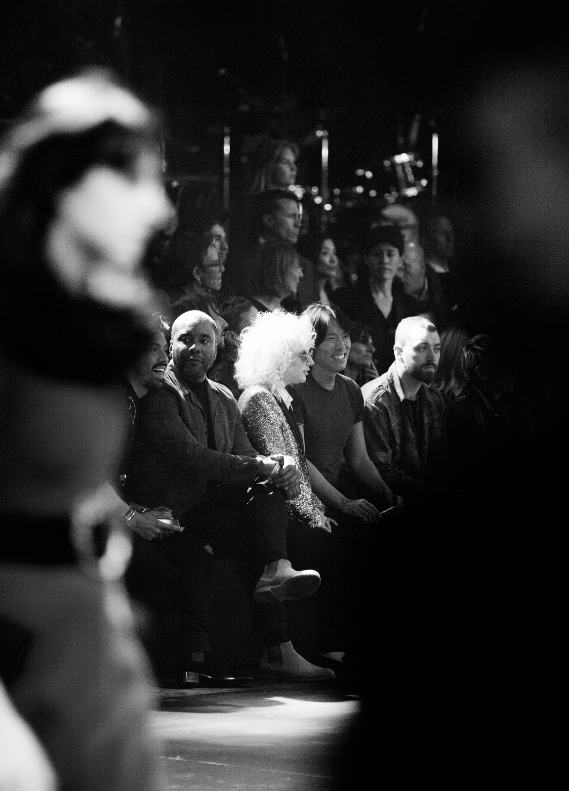 Lee Daniels, Lady Gaga and Sam Smith in the front row at Saint Laurent FW16 (Hedi Slimane) at the Palladium on February 10, 2016 in Los Angeles, California.