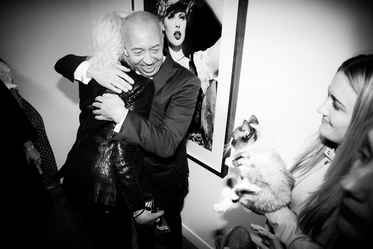 Benedikt Taschen is hugging Ellen von Unwerth at the opening night of Ellen von Unwerth's photography exhibition at TASCHEN Gallery on February 24, 2017 in Los Angeles, California.
