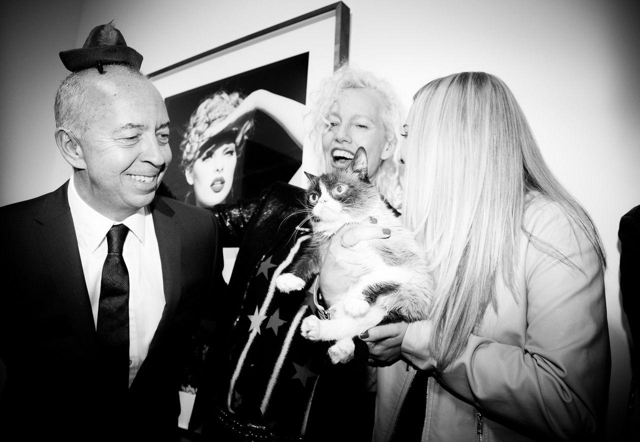 Benedikt Taschen, Ellen von Unwerth, Grumpy cat and her owner at the opening night of Ellen von Unwerth's photography exhibition at TASCHEN Gallery on February 24, 2017 in Los Angeles, California.