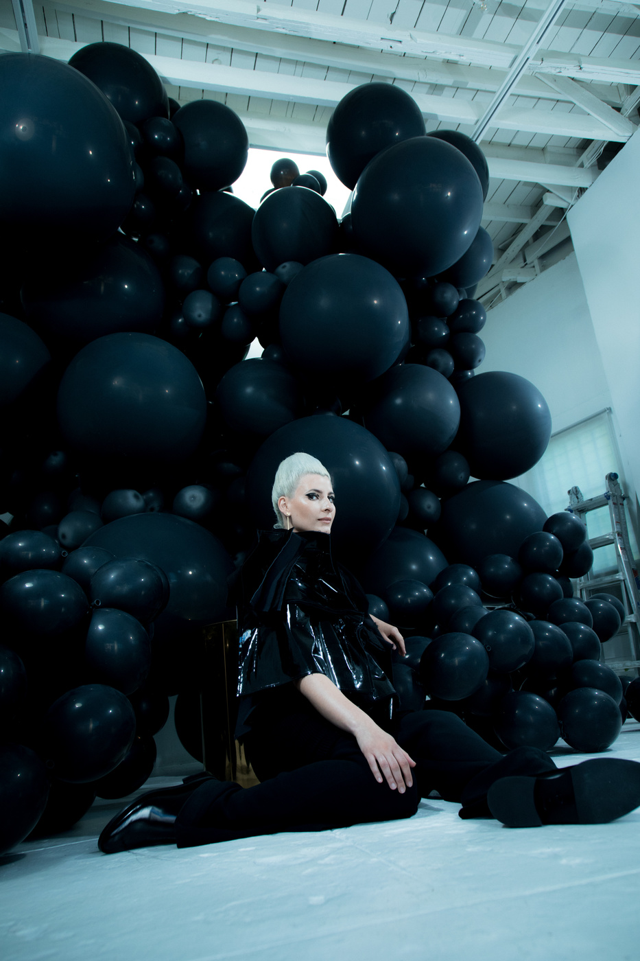 Artist Jihan Zencirli in her studio in Los Angeles in front of one of her installations photographed by Ger Ger.